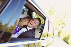 Groom and bride kissing in the car Stock Photo