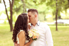 Groom and bride kissing Royalty Free Stock Photo