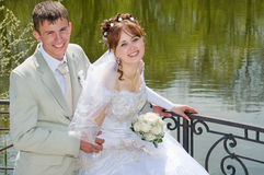 The groom and the bride on lake. Stock Photography
