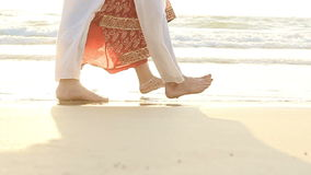 Groom Bride in Long Walk Barefoot in Shallow Water by Surf stock footage