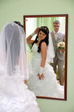The groom and the bride look in a mirror Stock Photography