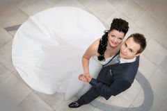 Groom and the bride look up Royalty Free Stock Photography