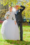 Groom with bride are looking ahead. Sunny autumn. Royalty Free Stock Photos