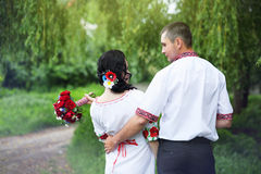 Groom and bride looking at each other Royalty Free Stock Photography