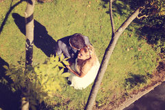 Groom and bride lying on grass Royalty Free Stock Images