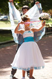 Groom and bride make some fun Royalty Free Stock Photo