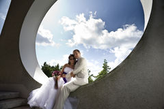 Groom and bride in modern architectural background Stock Photo
