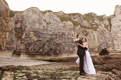 Groom and bride near big cliffs Royalty Free Stock Images