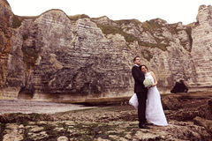 Groom and bride near big cliffs Royalty Free Stock Image