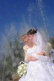 The groom and the bride near a fountain Royalty Free Stock Photography