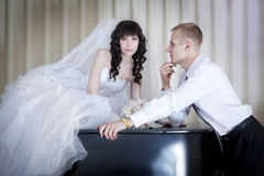 Groom and  bride near a grand piano Royalty Free Stock Images