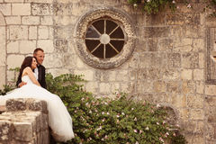 Groom and bride near an old building Royalty Free Stock Images
