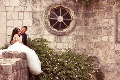 Groom and bride near an old building Royalty Free Stock Photo
