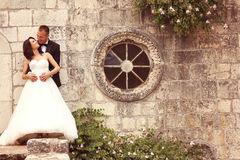 Groom and bride near an old building Royalty Free Stock Photos