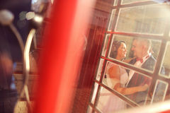 Groom and bride near phonebooth Royalty Free Stock Photography