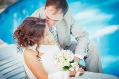 Groom and bride near the pool Stock Photos