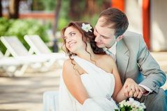 Groom and bride near the pool Royalty Free Stock Photography
