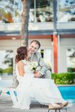 Groom and bride near the pool Royalty Free Stock Photos