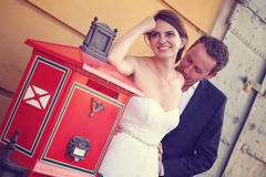 Groom and bride near a post office Royalty Free Stock Photography