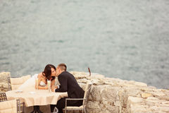 Groom and bride near the sea Royalty Free Stock Photo