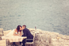 Groom and bride near the sea Royalty Free Stock Images