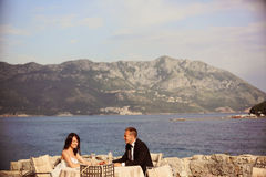 Groom and bride near the sea Royalty Free Stock Photos