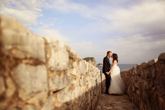 Groom and bride near the sea Royalty Free Stock Photography