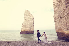 Groom and bride at Normandy shore Stock Photography