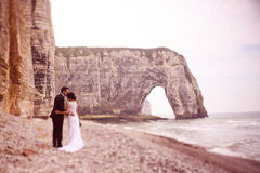 Groom and bride at Normandy shore Stock Image