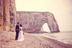 Groom and bride at Normandy shore Stock Photos