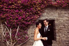 Groom and bride outdoors on their wedding day Stock Photo