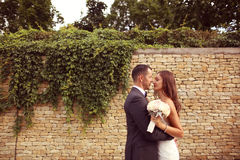 Groom and bride outdoors on their wedding day Stock Image
