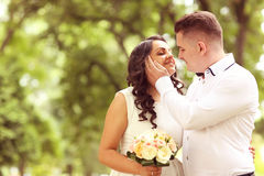 Groom and bride outdoors on their wedding day Royalty Free Stock Photography