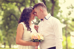 Groom and bride outdoors on their wedding day Royalty Free Stock Photo