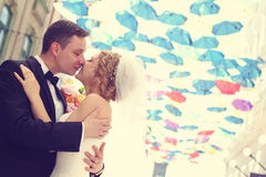 Groom and bride outdoors on their wedding day Stock Images