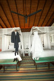 Groom and bride outfits in the hotel room. Royalty Free Stock Image