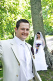 Groom and bride in park  background Stock Photos