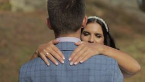 Groom with bride in the park. Wedding couple. Happy family in love stock video footage