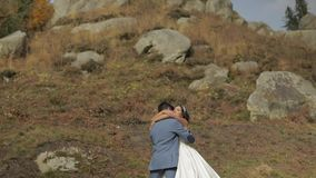 Groom with bride near mountain hills. Wedding couple. Happy family in love stock video footage