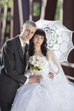 The groom and the bride on the railway bridge Royalty Free Stock Photo