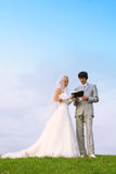 Groom and bride read Bible together royalty free stock image