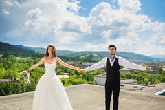 The groom with the bride on the rooftop Stock Photos