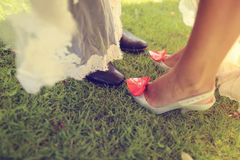 Groom and bride s feet Royalty Free Stock Images