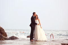 Groom and bride in the sea Royalty Free Stock Photo