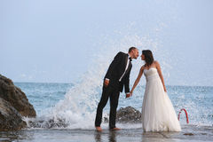 Groom and bride in the sea Royalty Free Stock Images