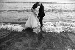 Groom and bride in the sea Royalty Free Stock Image