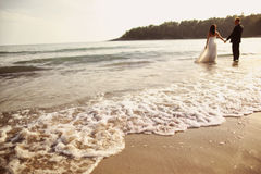 Groom and bride in the sea Stock Photography