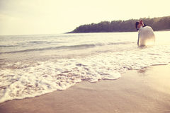 Groom and bride in the sea Stock Photos