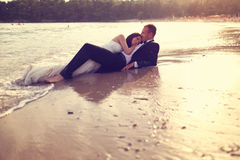 Groom and bride in the sea Royalty Free Stock Photography