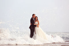 Groom and bride in the sea Stock Photo